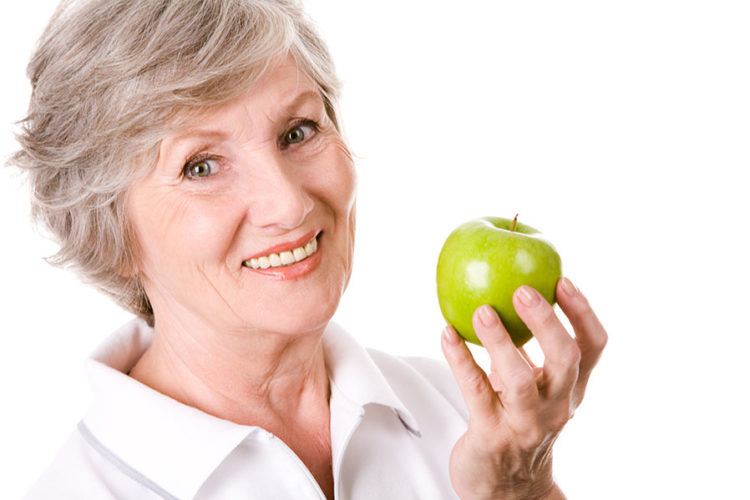 lady holding apple